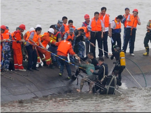 A survivor is rescued. Photo via Getty Images